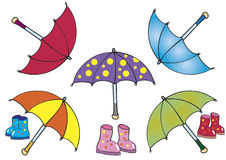 Umbrellas and boots. Five cartoon umbrellas and three pairs of boots Stock Photo