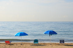 Umbrellas and chairs on the beach Royalty Free Stock Image