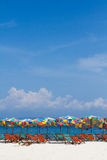 Umbrellas and chairs on the beach with bluesky Royalty Free Stock Photography