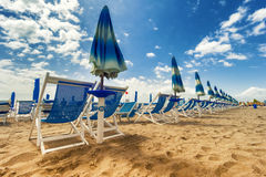 Umbrellas and chairs in Versilia, Italy Royalty Free Stock Photos