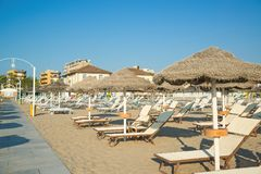 Umbrellas and chaise lounges on the beach of Rimini. In Italy royalty free stock photography