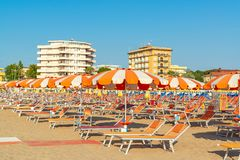 Umbrellas and chaise lounges on the beach of Rimini in Italy.  stock photo