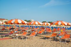 Umbrellas and chaise lounges on the beach of Rimini in Italy. Europe stock photography