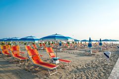 Umbrellas and chaise lounges on the beach of Rimini in Italy.  royalty free stock photo