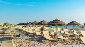 Umbrellas and chaise lounges on the beach of Rimini in Italy.  royalty free stock image