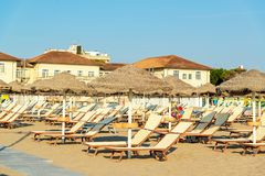 Umbrellas and chaise lounges on the beach of Rimini in Italy.  royalty free stock photos