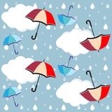 Umbrellas, clouds rain drops - vector, eps. Seamless pattern with colorful umbrellas, clouds and rain drops on blue sky background royalty free illustration