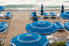 Umbrellas on the coast of France Stock Photos