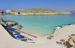 Umbrellas in Comino - Malta. Clear blue seas surrounding the island of Comino in Malta Stock Images