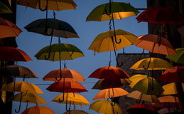 Umbrellas in the dark Stock Photography