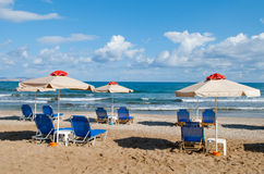 Umbrellas and deck-chairs Royalty Free Stock Photography