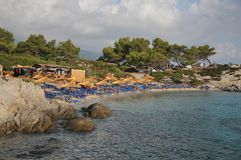 Umbrellas and deck chairs on the sandy beach. Neipori,greek,orange beach Royalty Free Stock Image