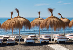 Umbrellas and deckchairs on a beach for tourists. Stock Photography