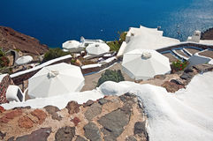 Umbrellas on the descent in Oia, Santorini, Greece Royalty Free Stock Images