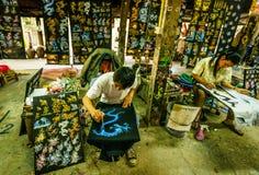 Umbrellas factory. CHIANG MAI, THAILAND - FEB. 15 :Painters in umbrella factory, February 15, 2014 in Chiang Mai, Thailand Royalty Free Stock Photos