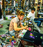 Umbrellas factory. CHIANG MAI, THAILAND - FEB. 15 :Painters in umbrella factory, February 15, 2014 in Chiang Mai, Thailand Royalty Free Stock Photography