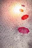 Umbrellas flow in the sky with rain drop. And sunlight Stock Photo
