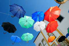 Umbrellas flying at Evora, Portugal Stock Photo