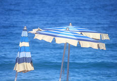 Umbrellas in front of the sea. On holiday Royalty Free Stock Photo