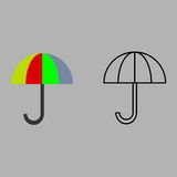 Umbrellas on a gray background. Isolated umbrellas on a gray background. Can be used as icons Stock Images