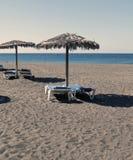 Umbrellas and hammocks in the beach Royalty Free Stock Photo