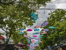 Umbrellas hang with the tree in Chatuchak Weekend Market Bangkok royalty free stock photo
