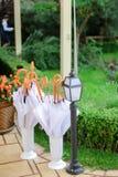 Umbrellas hanging outside near lantern. royalty free stock images