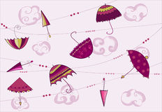 Umbrellas hanging on the rope Royalty Free Stock Photo