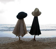Umbrellas and hats Stock Images