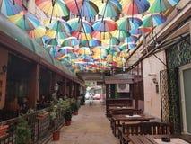 Umbrellas. Hidden secret small street colorful traditional romanian Stock Images
