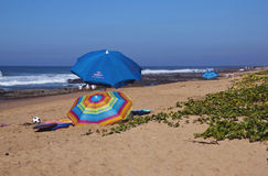 Umbrellas and Leisure Equipment on Sheffield Beach Royalty Free Stock Photo