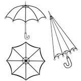 Umbrellas. Line drawing. Black and white. stock illustration