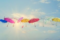 Umbrellas line-up across the sky Royalty Free Stock Photography