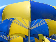 Umbrellas. Love the way umbrellas were lined up and contrast between sky and blue on umbrellas Stock Photo