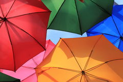 Umbrellas many. Many bright and colourful umbrellas suspending and hanging shot from below Royalty Free Stock Image