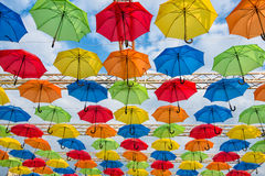 Umbrellas. Many umbrellas coloring the sky Stock Images