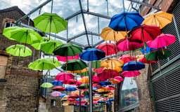 Umbrellas in many colors hanging in open air Royalty Free Stock Photography