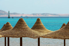 Umbrellas, Mount and Red Sea. Umbrellas and Red Sea on mount background Stock Image