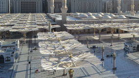 Umbrellas in Nabawi Mosque time lapse at afternoon. In saudi arabia stock video footage