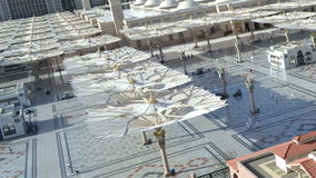 Umbrellas in Nabawi Mosque time lapse at afternoon. In saudi arabia stock video