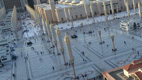 Umbrellas in Nabawi Mosque time lapse from afternoon to sunset. In saudi arabia stock footage