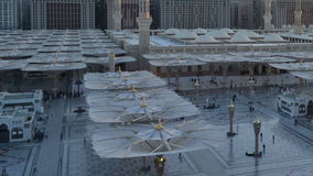Umbrellas in Nabawi Mosque time lapse from dawn to morning Royalty Free Stock Photo
