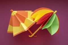 Umbrellas origami paper cut. Two colorful paper umbrellas royalty free stock photography