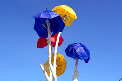 Umbrellas over blue sky Royalty Free Stock Photo