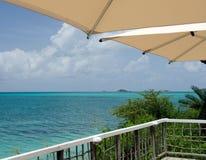 Umbrellas over Caribbean infinity pool Royalty Free Stock Photo