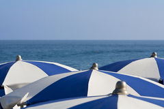 Umbrellas over the sea Stock Photography