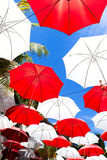 Umbrellas over sky background Stock Photos