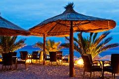 Umbrellas on Pebble Beach at Night royalty free stock photography