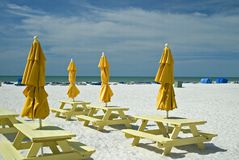 Umbrellas and picnic tables Royalty Free Stock Images