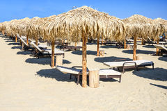 Umbrellas and plank beds. On a beach Royalty Free Stock Images